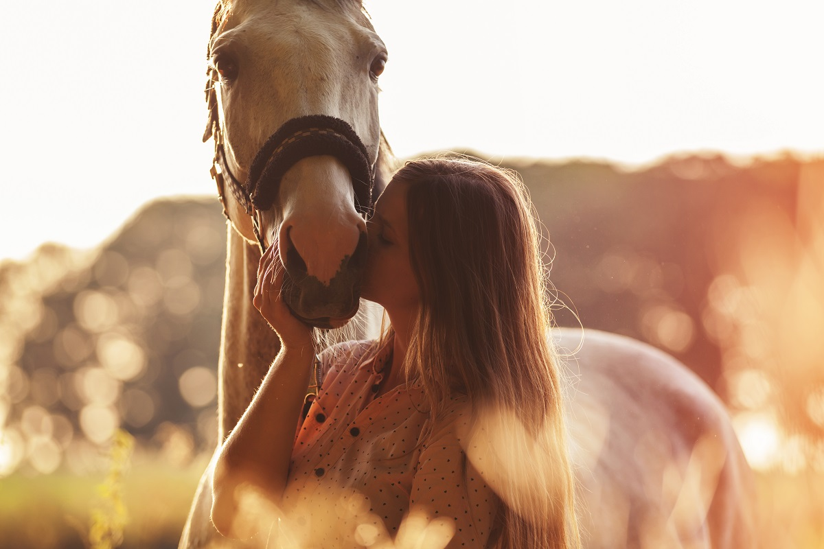 Woman kissing her horse