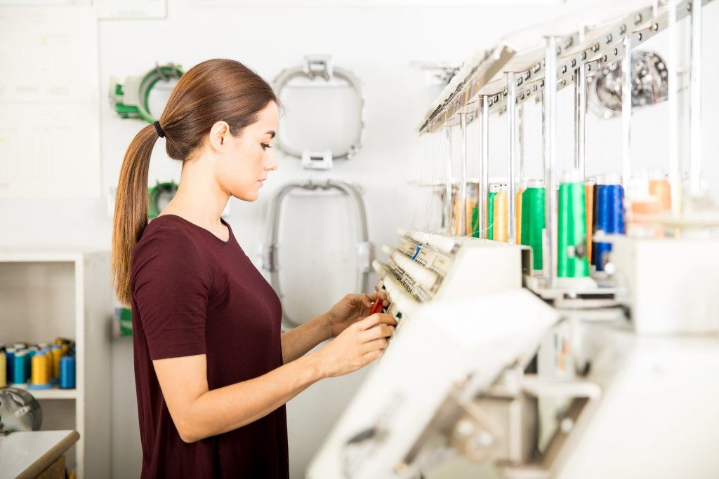 Woman setting up embroidery machine